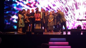 Team Mill on stage collecting the award