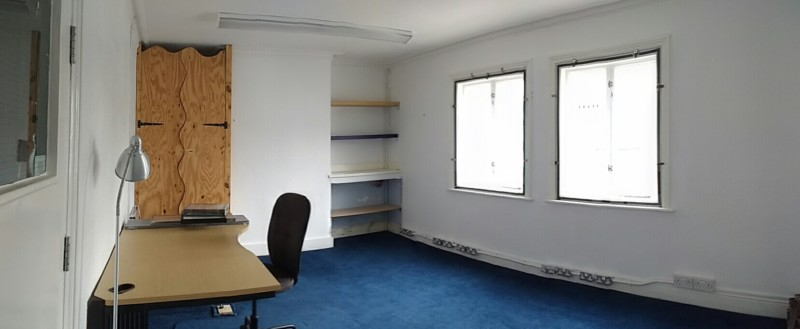Office with desk, windows and carpet