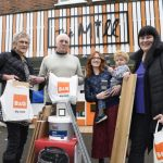 Mill volunteers with staff from B&Q
