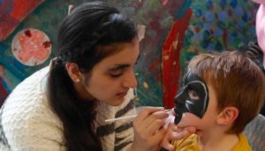 Child having face painted