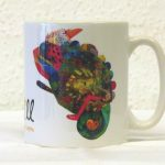 George the chameleon mug