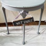 Side table in chalk paint with wet paint sign