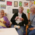 Joyce, center, knitting with members of the Mill Knitters Group