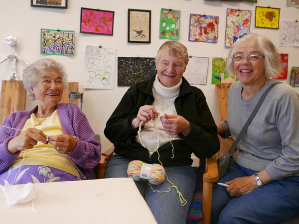 Joyce knitting with members of the Mill Knitters Group
